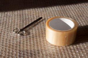 scissors tape bubble warp