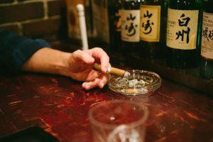 Japanese whiskey, cigar, at a bar, at a counter, keep a whiskey bottle at a bar is social status in Japan