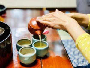 Kyusu teapot and Yunomi teacupes, Japanese tea set, pouring green tea