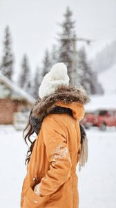 woman, a heavy winter coat,